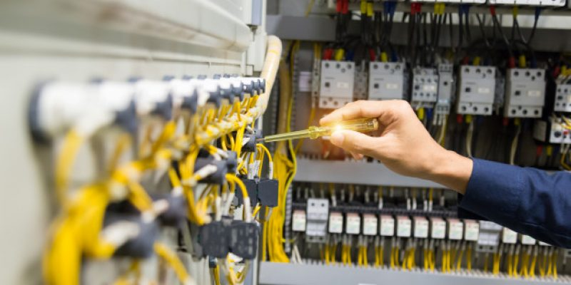 electricians-hands-testing-current-electric-control-panel_34936-1561